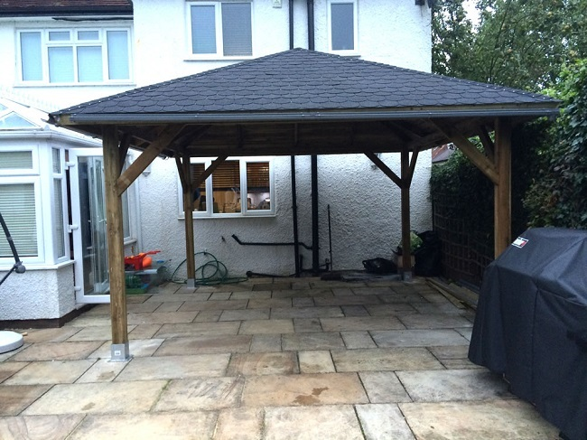 Classico gazebo installed close to a house wall