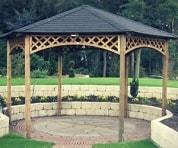 Large hexagonal wooden gazebo set over a patio