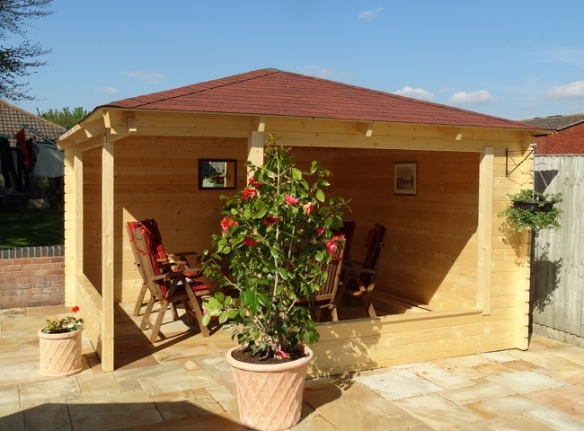 Marit wooden gazebo erected within a back garden in Oxfordshire