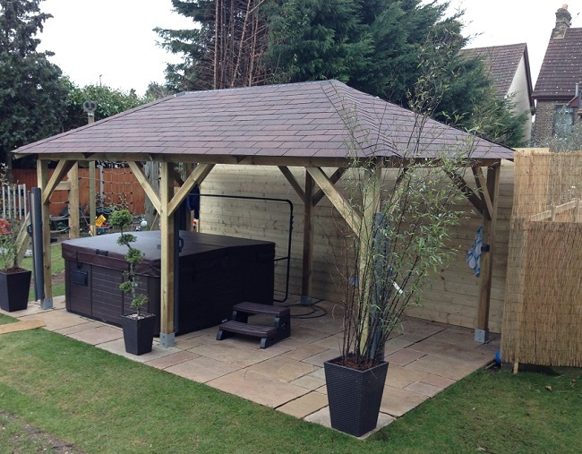 Superior wooden gazebo used to cover a patio and hot tub