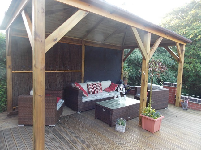 Grande timber gazebo with modified back walls